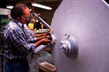 Jim Dow working on the Enterprise miniature's impulse engine housing, with the original bridge superstructure clearly show.