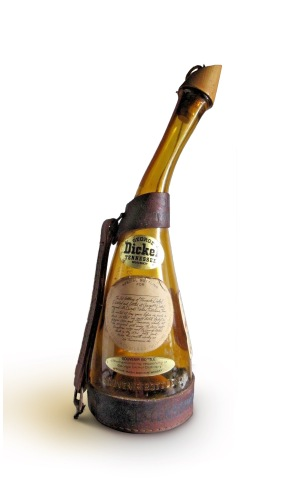 "Light amber glass 1/4 gallon ""powderhorn"" commemorative whiskey bottle originally produced by George Dickel Distillery in in 1964."