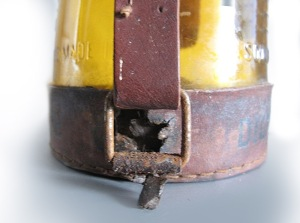 Detail of the torn-out bottom leather attachment that will need to be repaired or replaced.