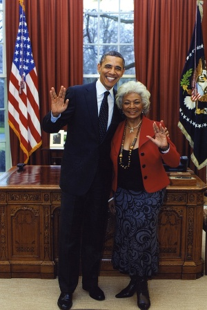 President Barack Obama flashing the Vulcan salute with groundbreaking Star Trek actress Nichelle Nichols during a White House visit on April 4, 2012.