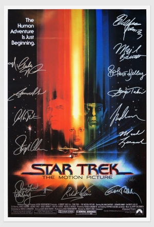 Autographed Star Trek: The Motion Picture poster. Signed by (clockwise from upper right): Walter Koenig (Chekov), Majel Barrett (Chapel), DeForest Kelley (McCoy), George Takei (Sulu), Leonard Nimoy (Spock), Mark Lenard (Klingon Captain), Gene Roddenberry (Producer), Robert Wise (Director), Grace Lee Witney (Rand), Stephen Collins (Decker), William Shatner (Kirk), James Doohan (Scotty). Nichelle Nichols (Uhura).