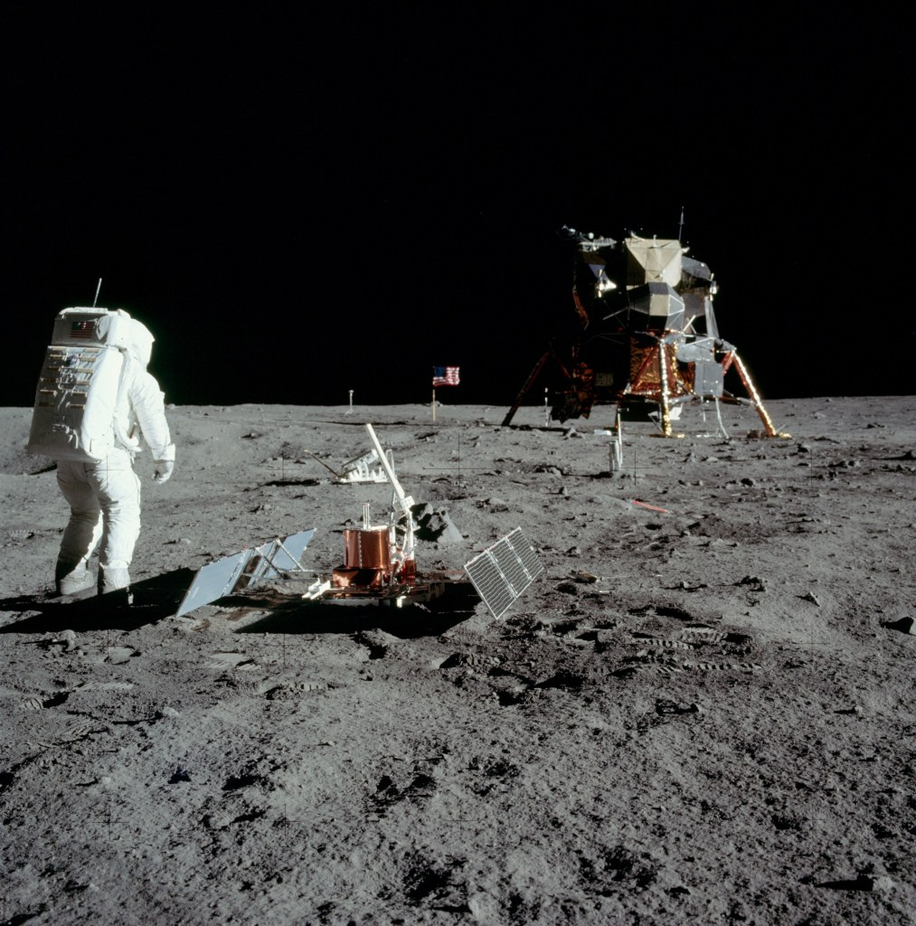 Image of Buzz Aldrin standing next to the Passive Seismic Experiment Package (PSEP) with the Lunar Excursion Module (LEM) in the background, taken by Neil Armstrong on the moon, July 20th 1969. (Image courtesy: NASA)