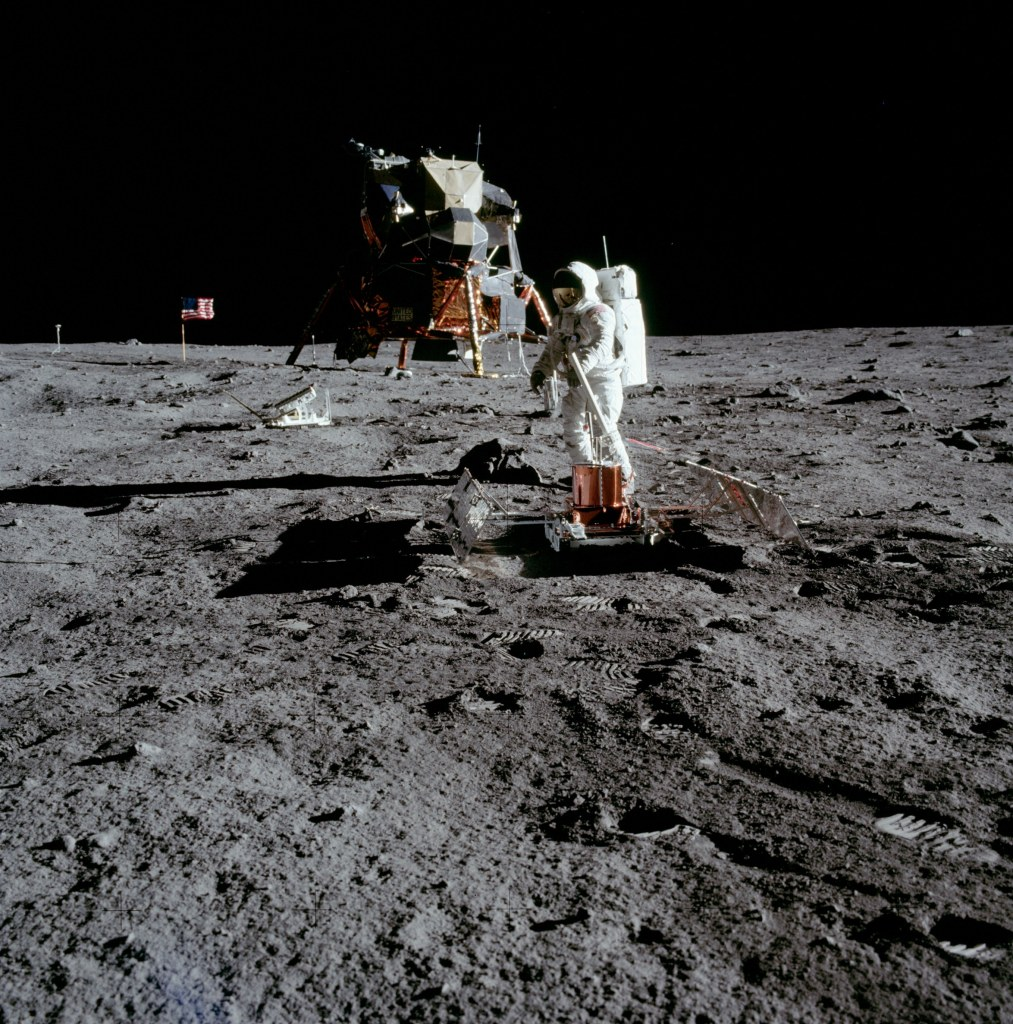 Image of Buzz Aldrin deploying the Passive Seismic Experiment Package (PSEP) with the Lunar Excursion Module (LEM) in the background, taken by Neil Armstrong on the moon, July 20th 1969. (Image courtesy: NASA)