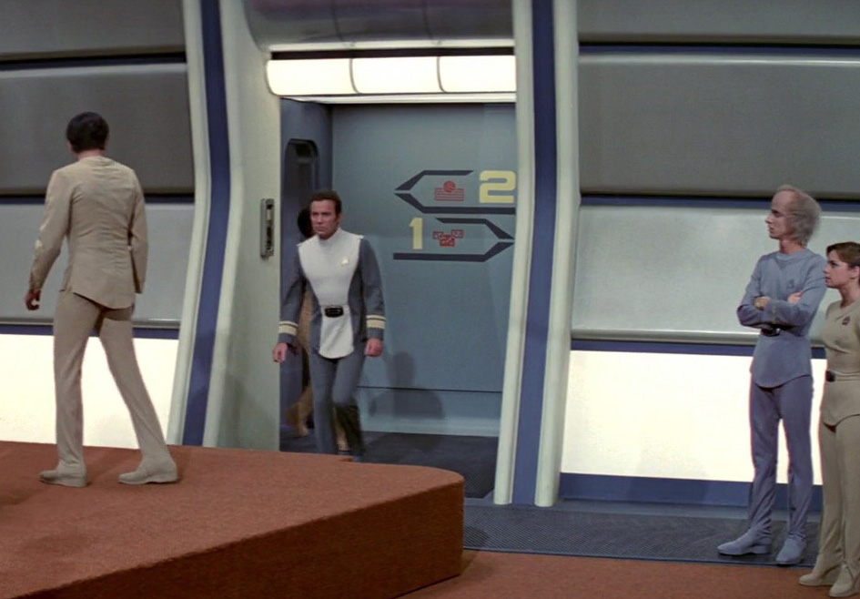 Detail from a screen grab of the recreation deck scene from Star Trek: The Motion Picture, where Kirk briefs the crew. The image shows some of the directional graphics by Lee Cole in the alcove. (Image: Courtesy Paramount Pictures)